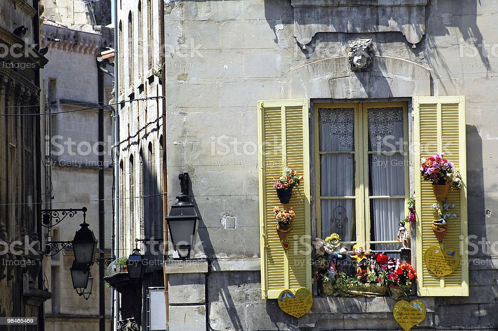 Arles (Provence, France) - House exterior, window with yellow shutters royalty-free stock photo
