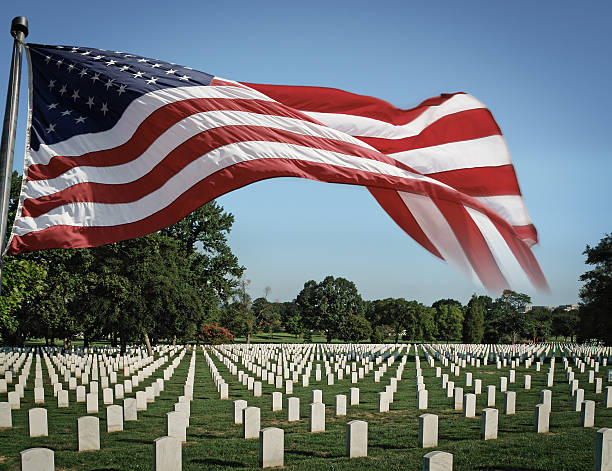 arlington national cemetery and us flag - arlington national cemetery stock pictures, royalty-free photos & images