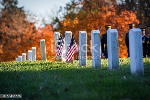 Gravestones of The Arlington National Cemetery during The Veteran's Day in United States in November, late autumn