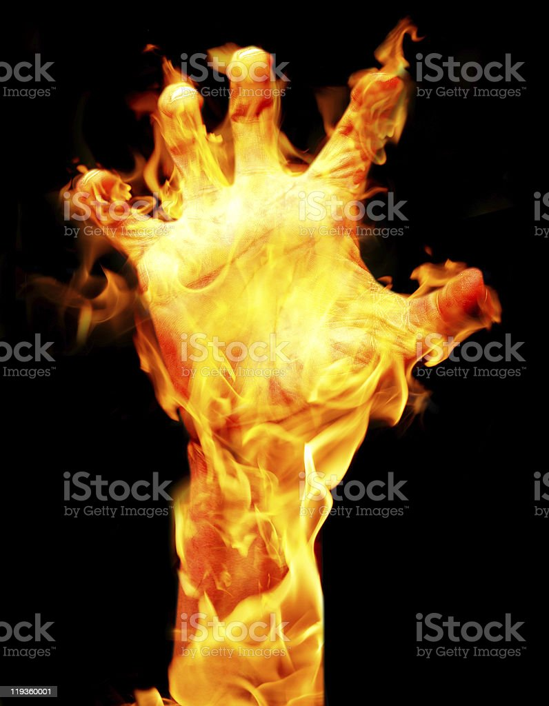 Arm and hand on fire with black background. stock photo