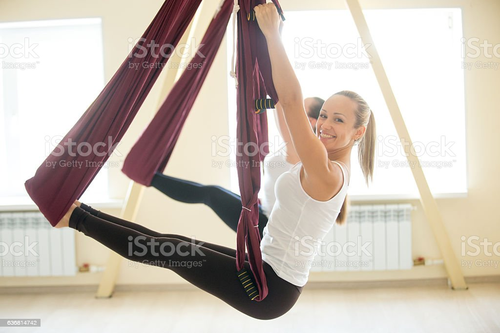 Arm balance exercise in hammock stock photo