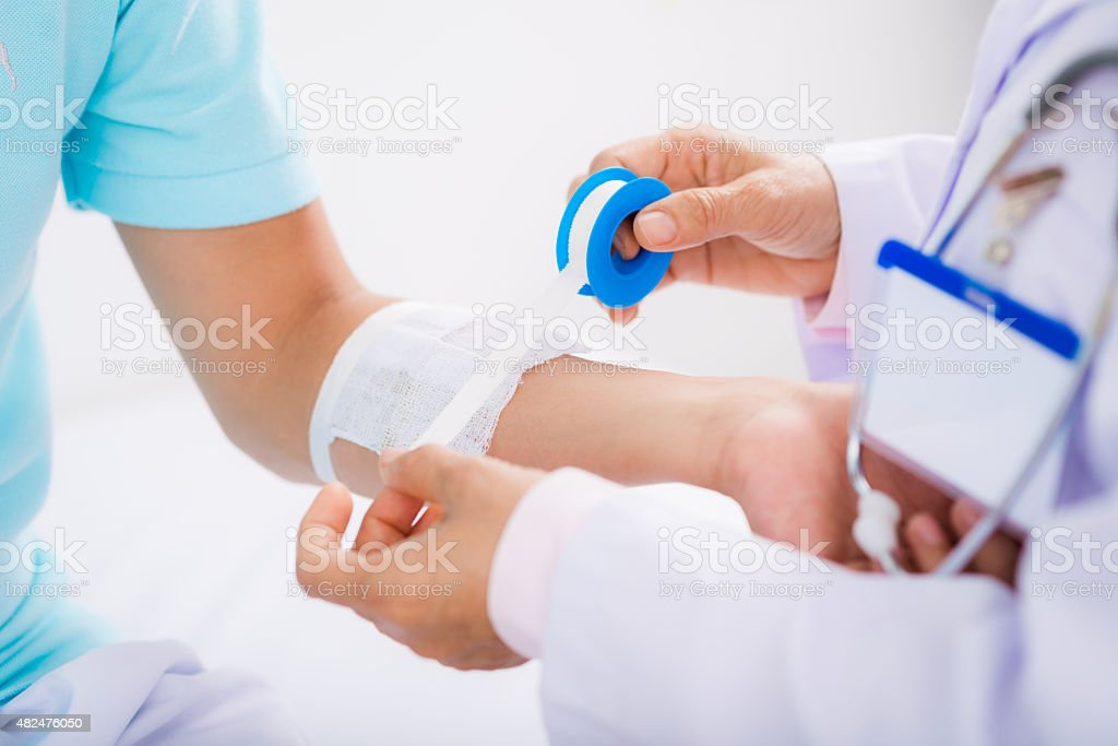 Arm bandaging stock photo