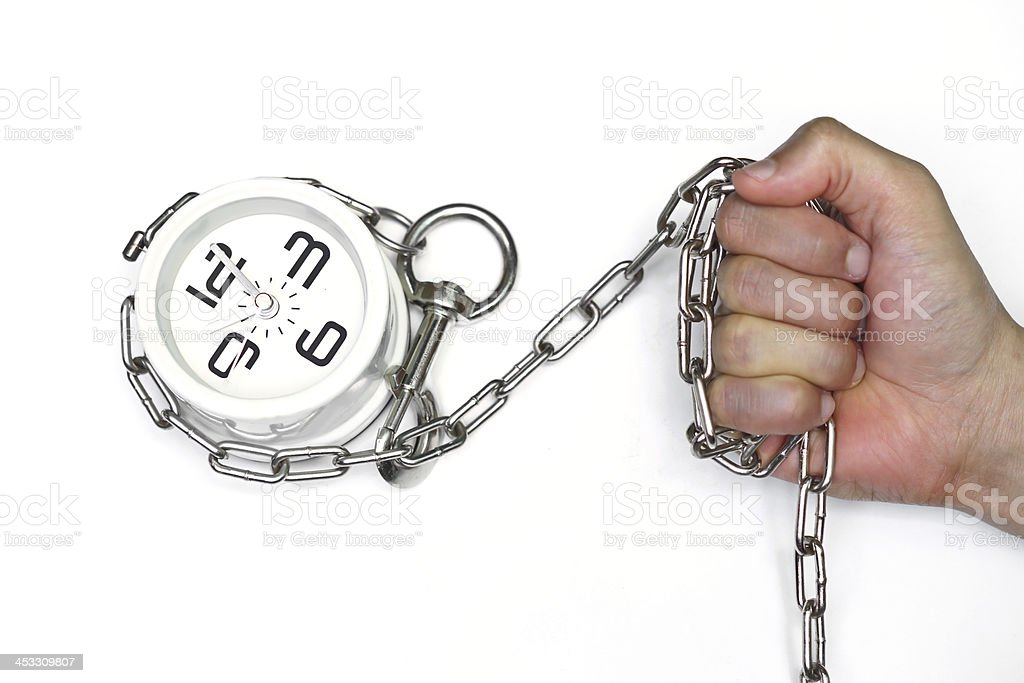 arm chained with a clock stock photo