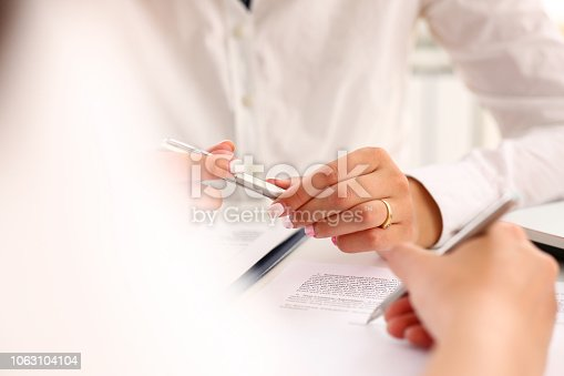 istock Arm fill and sign important form clipped to pad 1063104104