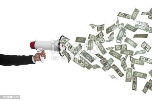 istock Arm holding megaphone speaking money 468984653