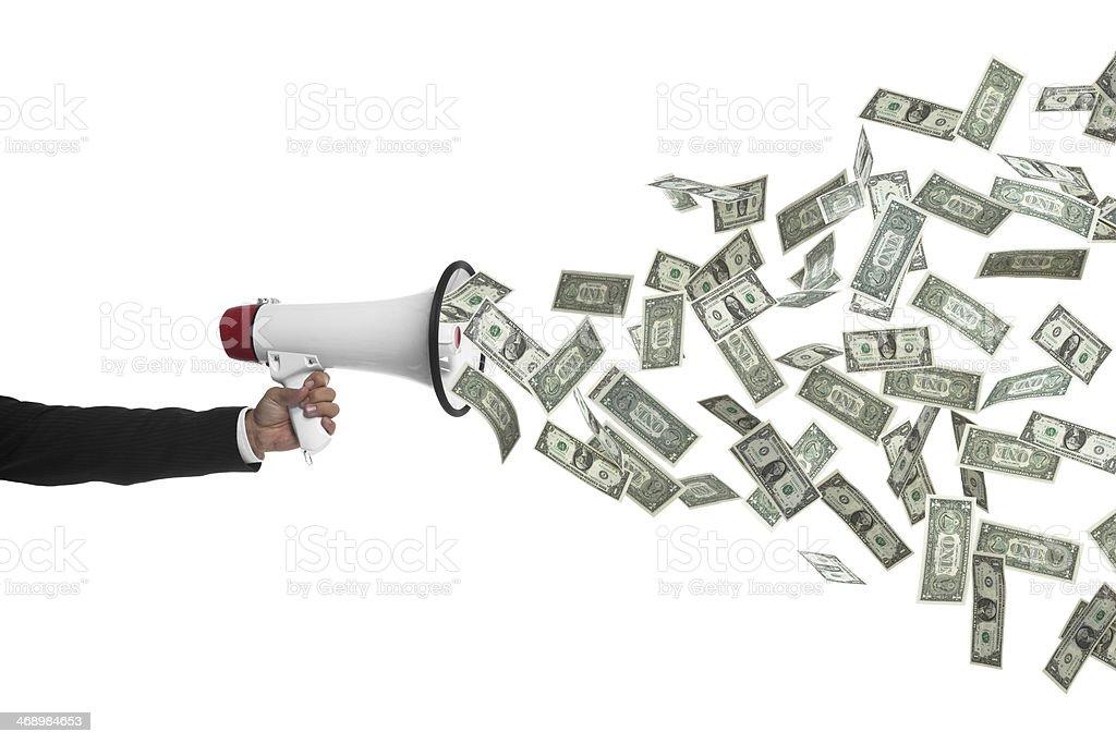 Рука держит Рупор выступая денег стоковое фото