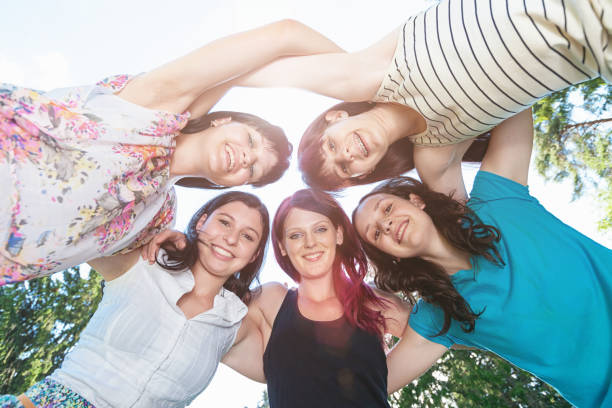 Arm in Arm Teenage Girls Together stock photo