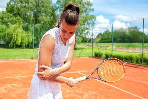 Arm injury during tennis practice stock photo