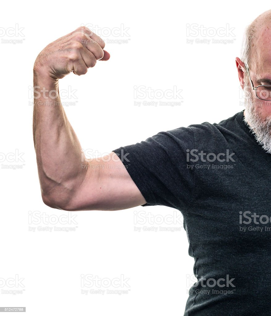 Arm Muscle Flexing Black T-Shirt Senior Adult Man A balding, grey bearded senior adult man wearing a black t-shirt is proud to show off the results of his cross training exercise routine by flexing his arm muscle. Active Lifestyle Stock Photo