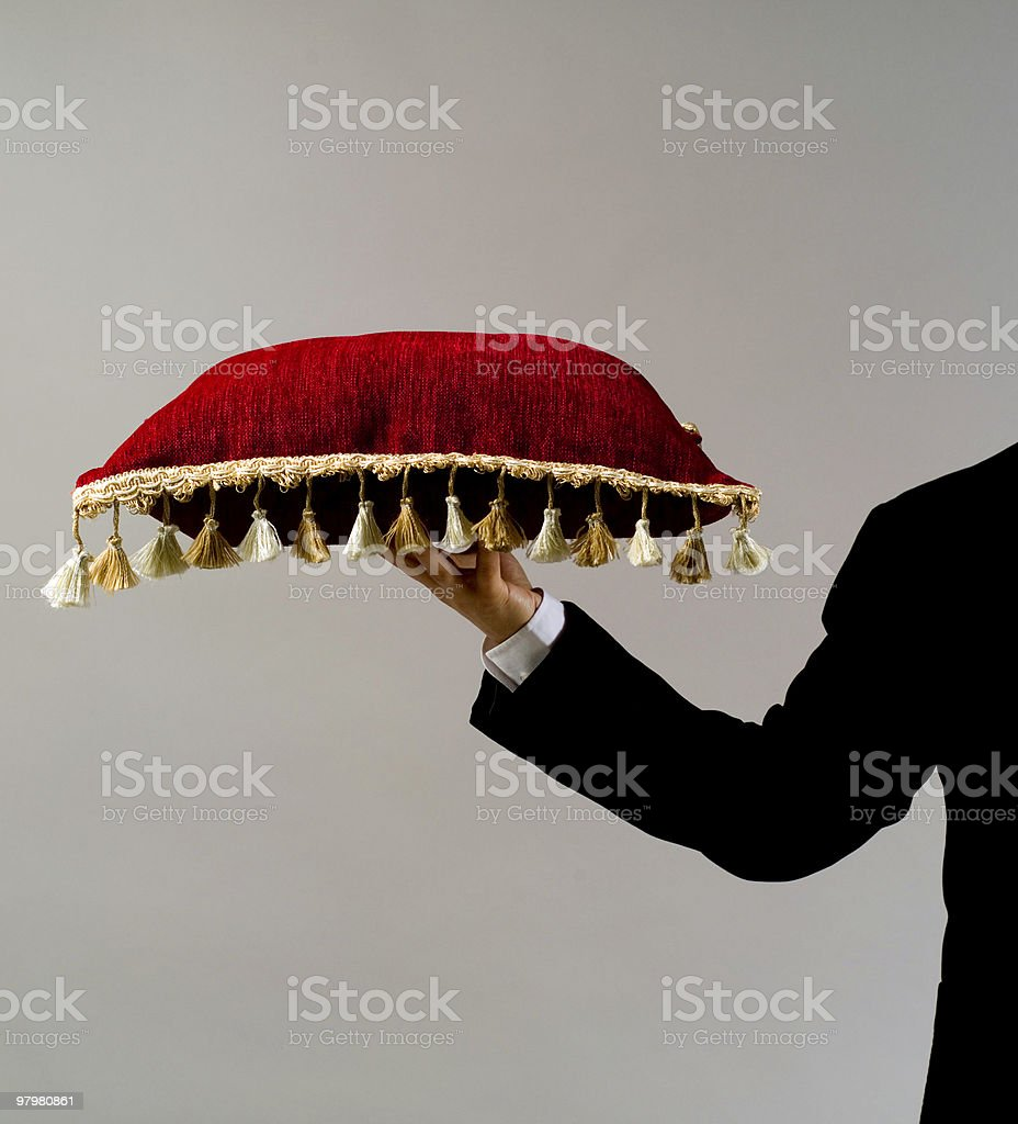 Arm Of Butler Holding Pillow. stock photo
