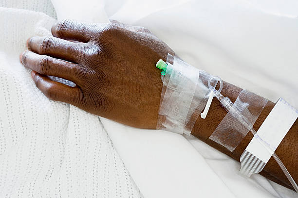 Arm of patient with drip stock photo