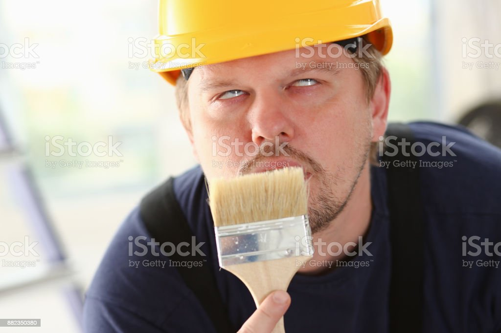 Arm of smiling worker hold brush stock photo