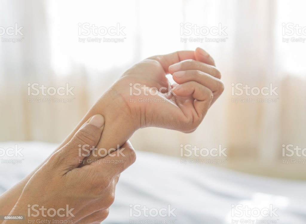 arm pain of old women stock photo