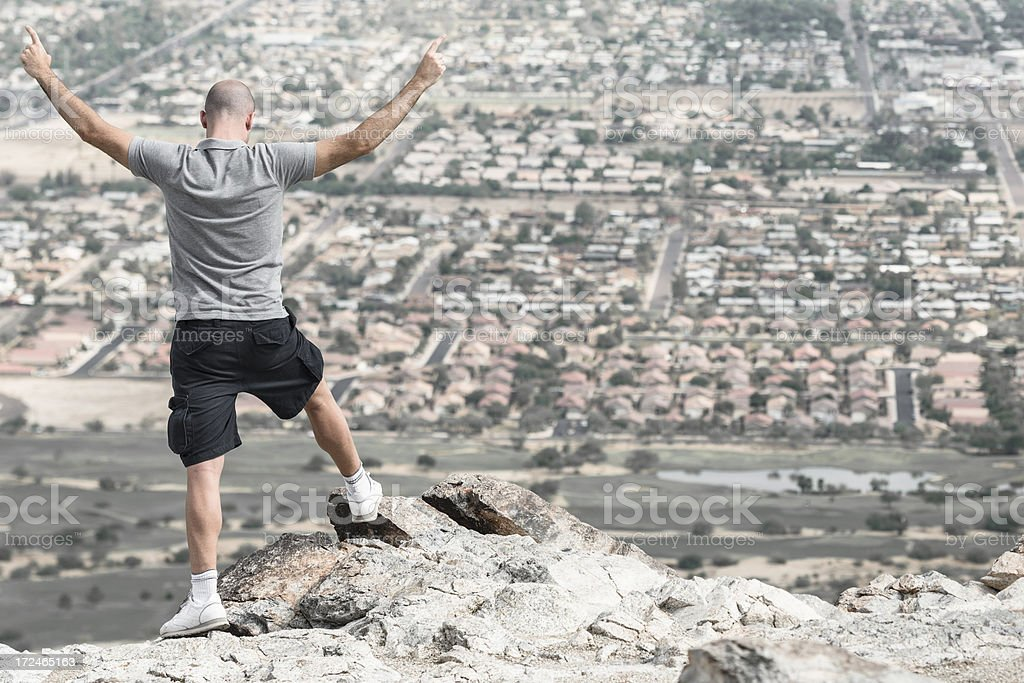 Arm raised on top of the mountain royalty-free stock photo
