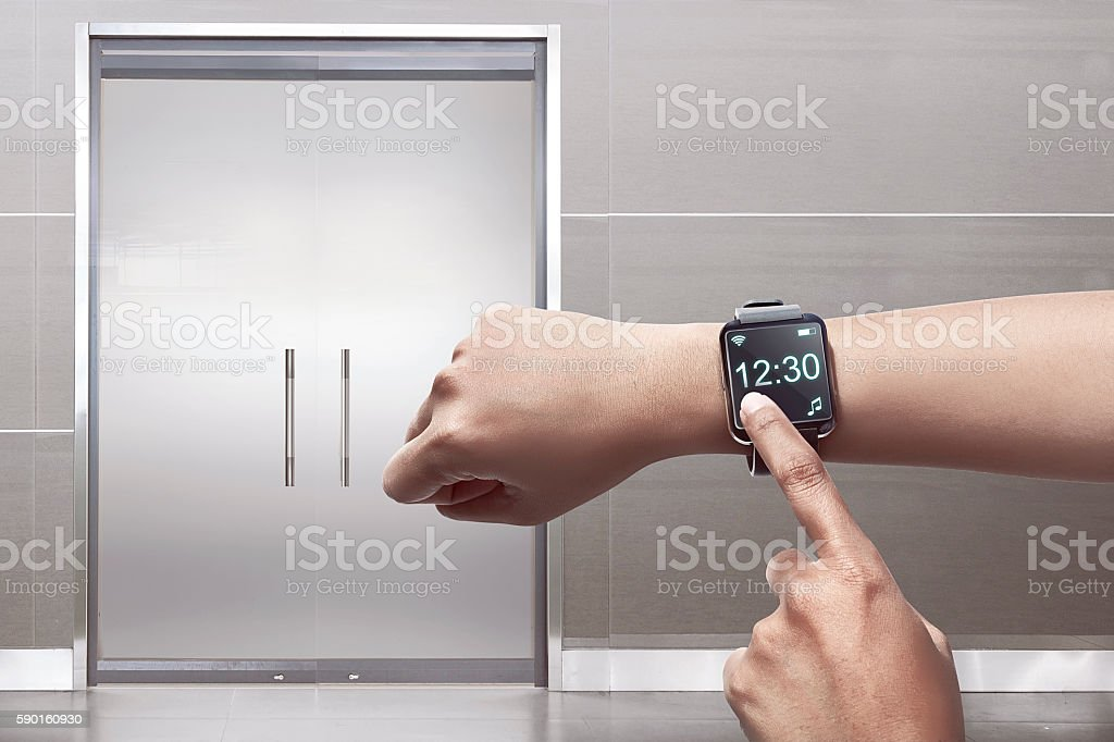 Arm with smartwatch stock photo