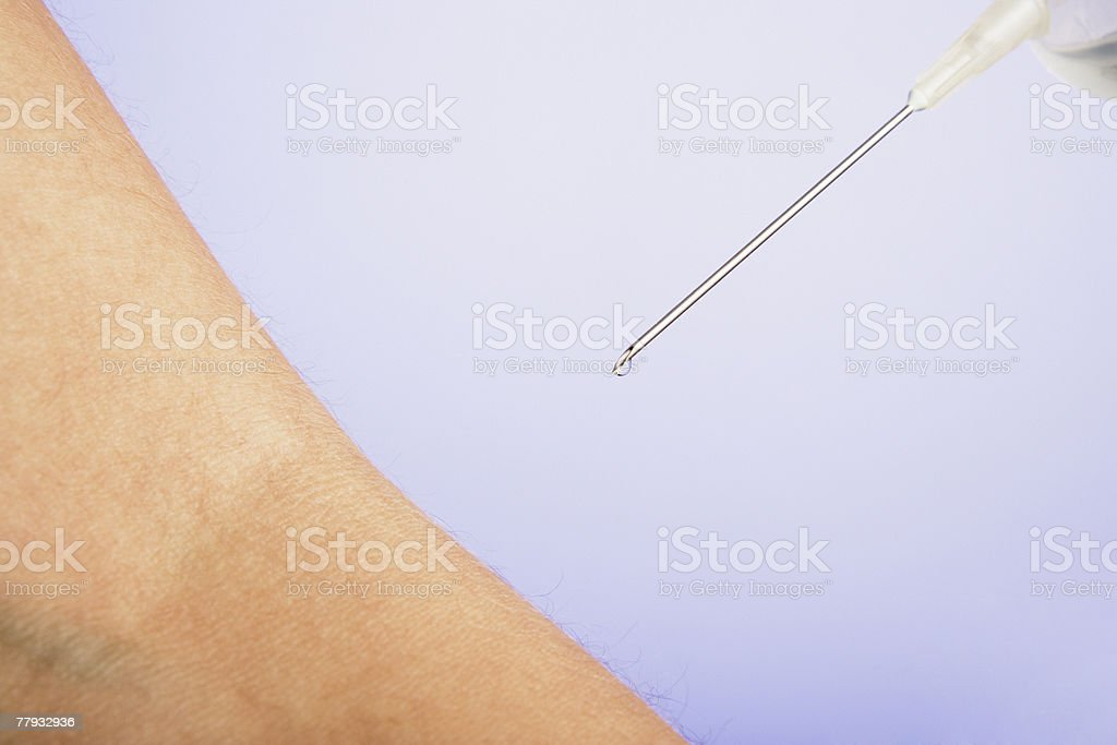 Arm with syringe royalty-free stock photo
