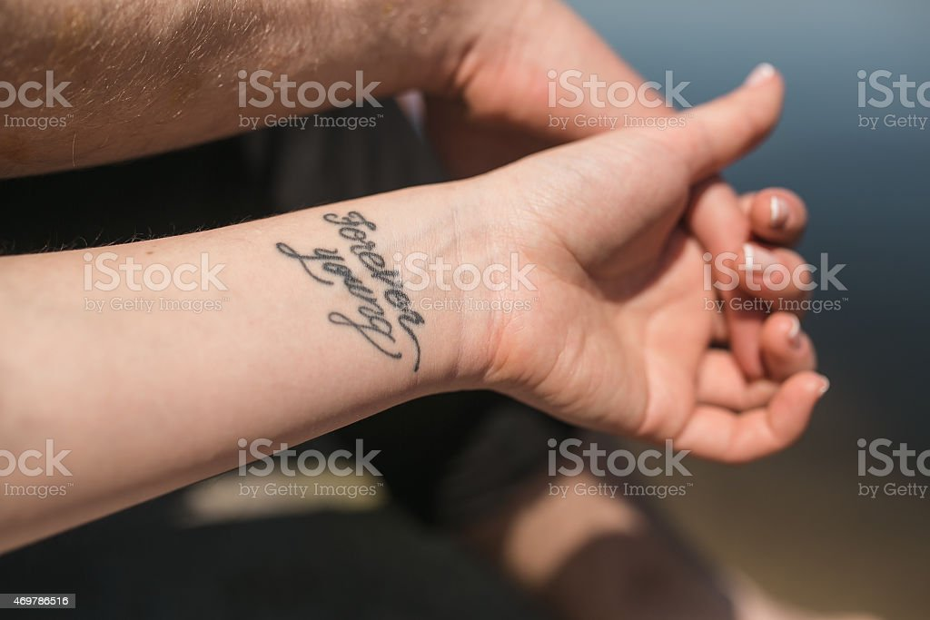 arm with tattoo stock photo