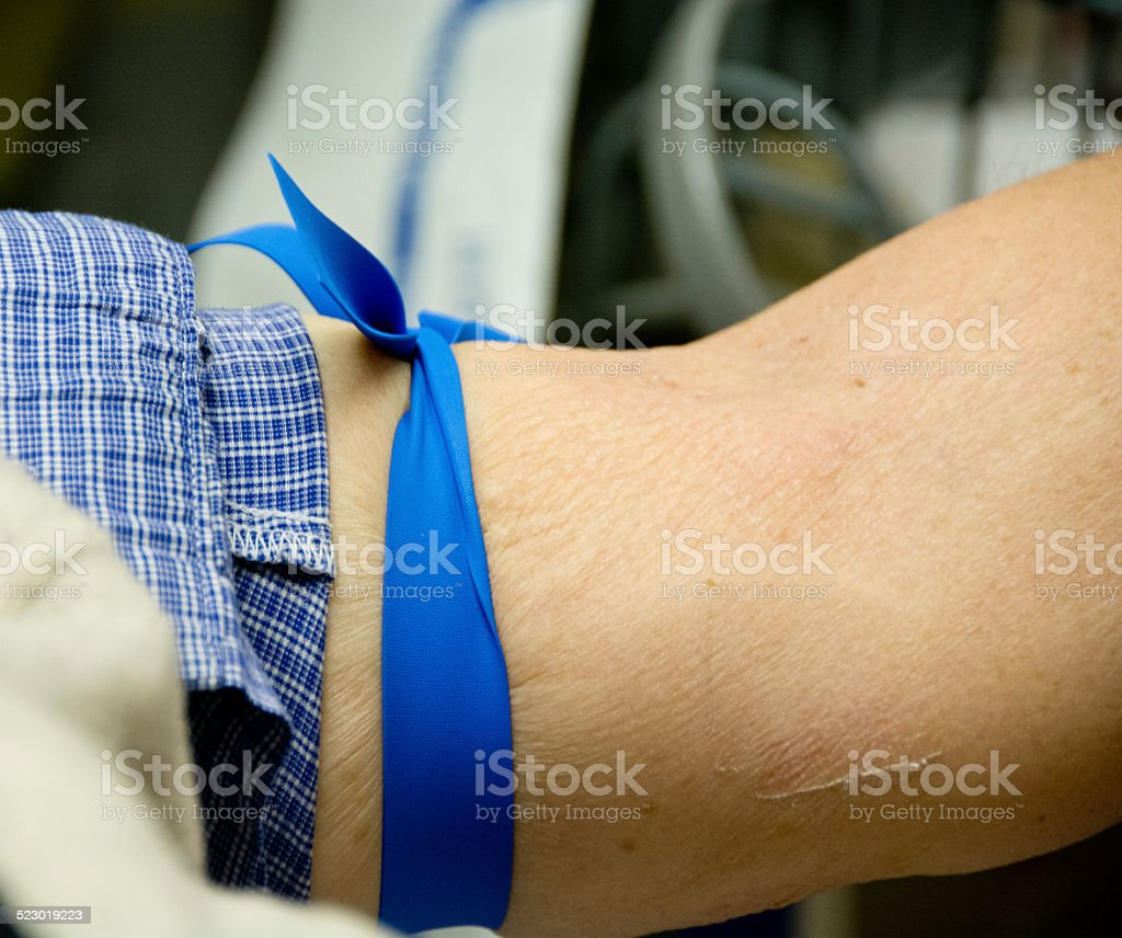 Arm with tourniquet for a blood test stock photo
