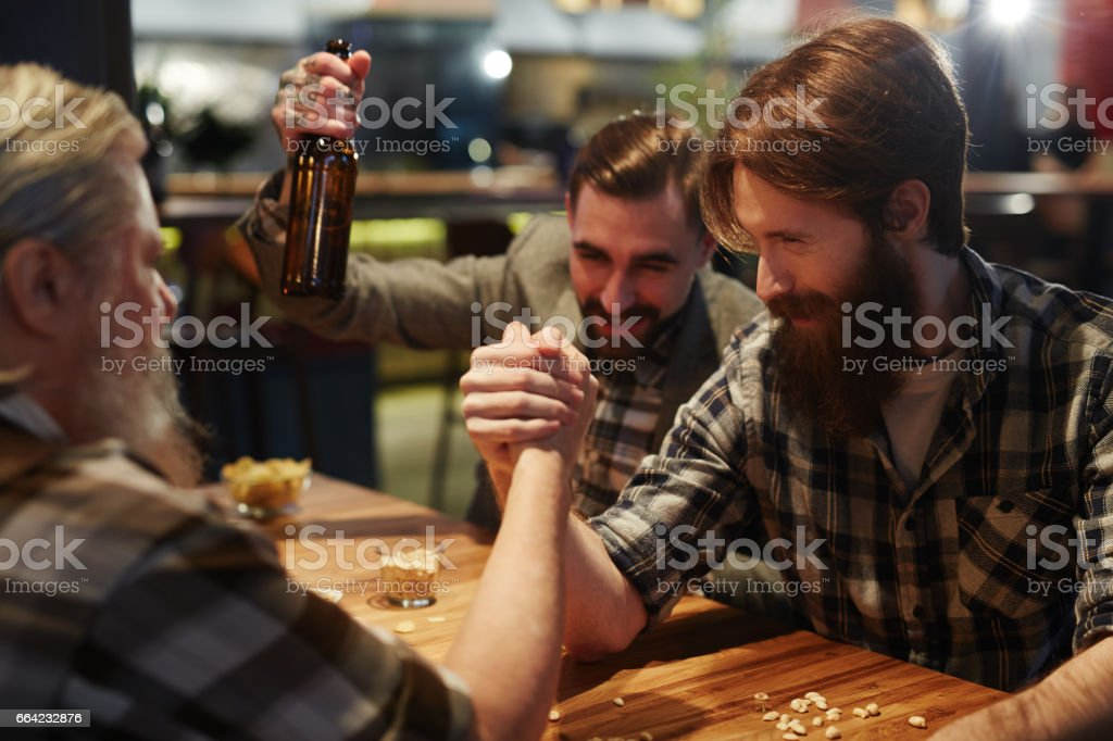 Arm wrestling in pub stock photo