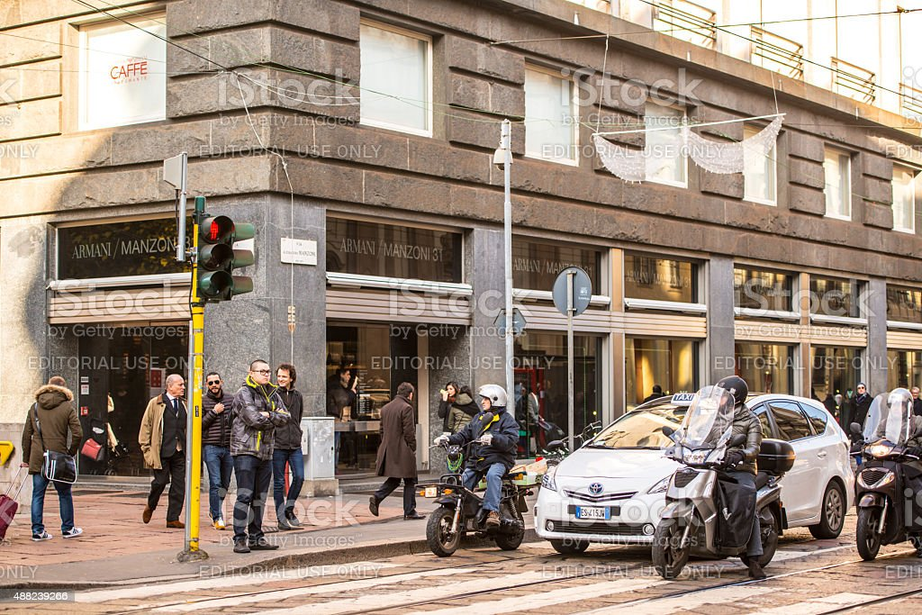 Armani Store, people and traffic on Via Alessandro Manzoni, Mila stock photo