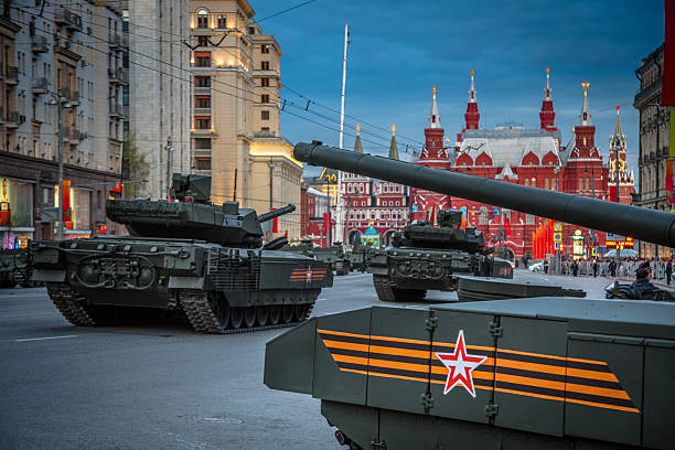 Armata T-14 main russian battle tank Moscow - Russia 4 May, 2015: Armata T-14 main battle tank unique, next generation heavy military vehicle, combat platform with soldiers and people on roadside for see the parade rehearsal on May 4, 2015 in Tverskaya street  Moscow. military parade stock pictures, royalty-free photos & images