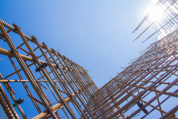 Armature against the blue sky. Metal base of reinforced concrete walls. Part of the structure of the building of reinforced concrete. rod stock pictures, royalty-free photos & images