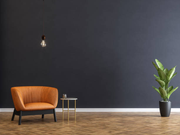 armchair and coffee table with black wall - wall foto e immagini stock