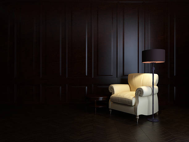 armchair and  floor lamp stock photo