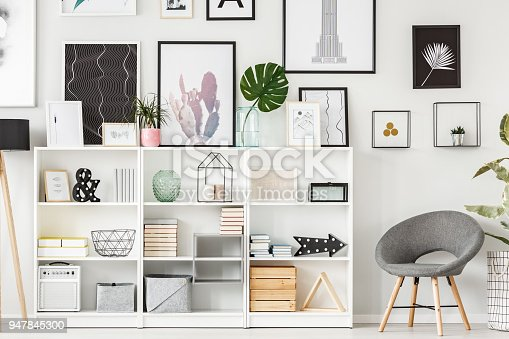 istock Armchair and shelf 947845300