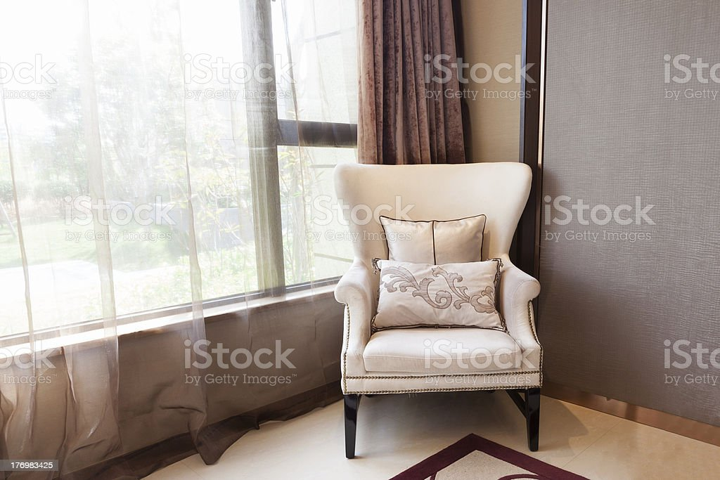 Armchair close to  the window royalty-free stock photo