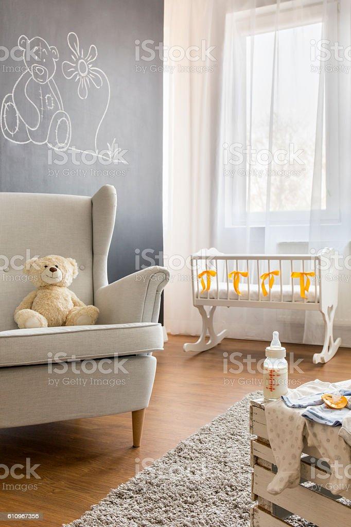 Armchair in baby room foto