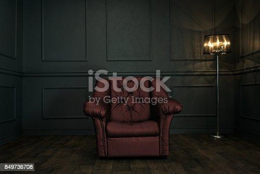 istock Armchair in dark elegant room 849736708