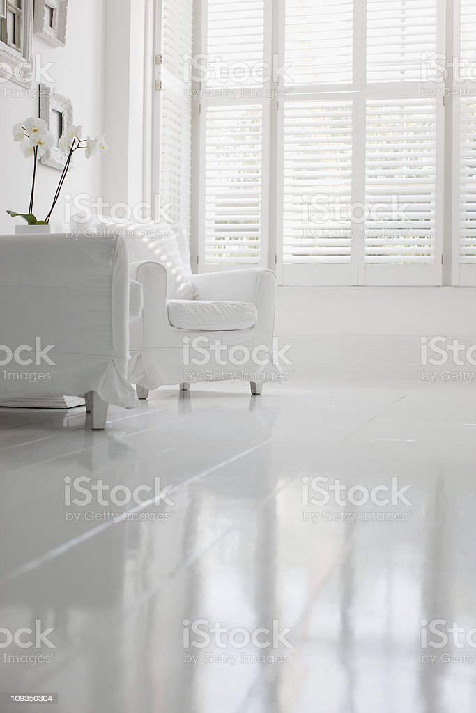 Armchair in elegant white living room stock photo