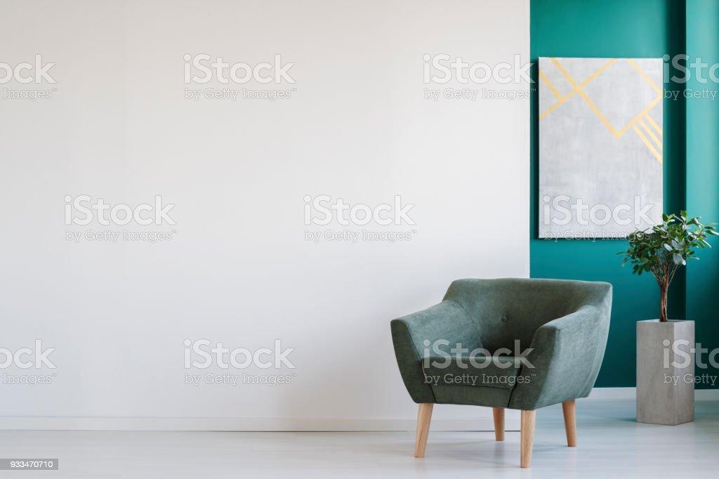 Armchair on empty wall stock photo
