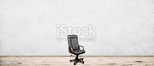 Black leather armchair in room. Business interior background