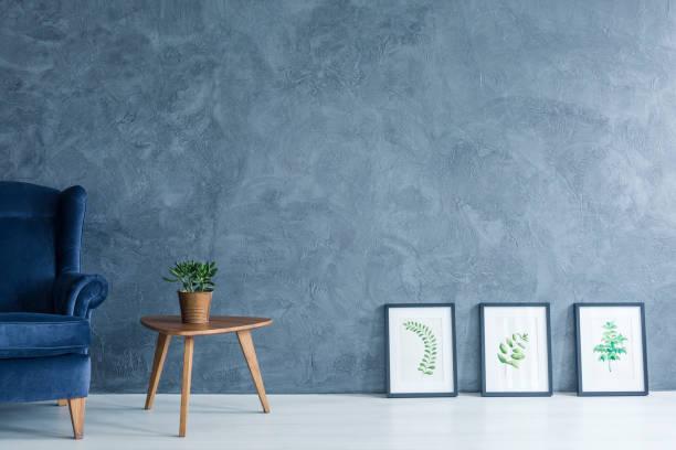 armchair, side table and paintings - bemalte tontöpfe stock-fotos und bilder