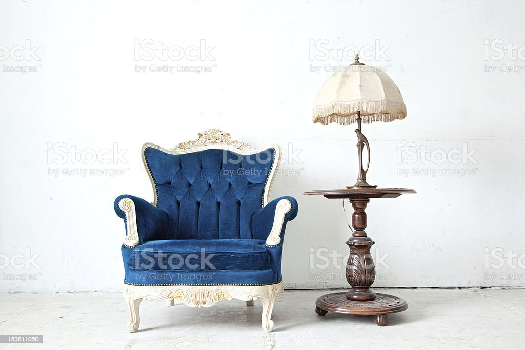 Armchair with desk lamp in vintage room stock photo