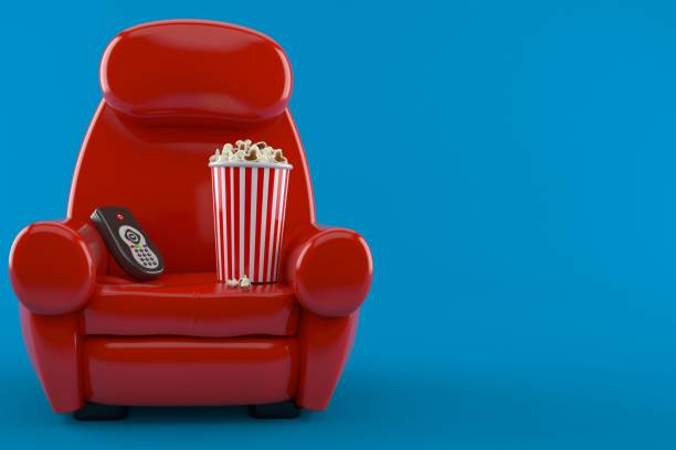 Armchair with popcorn and remote - foto stock