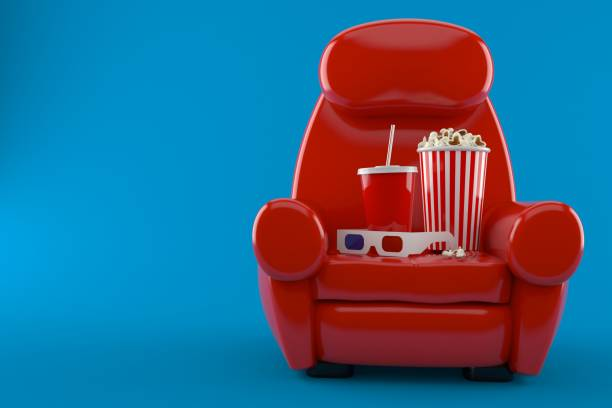 Armchair with popcorn and soda stock photo