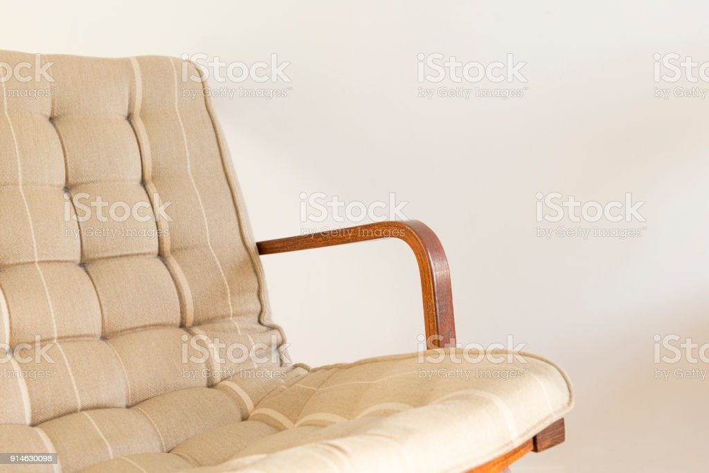 Armchair with Riveted Cushion Backrest on a White Background stock photo