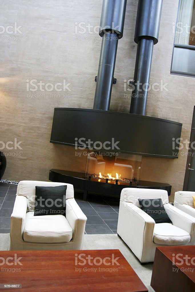 Armchairs and fireplace stock photo