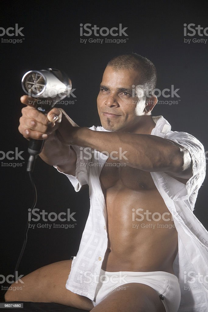 armed and dangerous with a hairdryer royalty-free stock photo