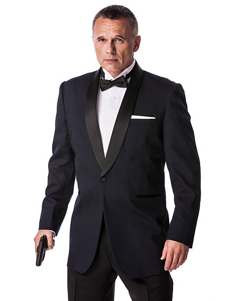 Armed Businessman in Tuxedo stock photo