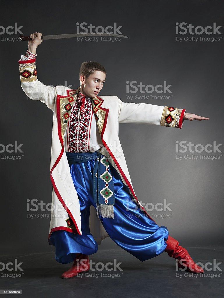 armed cossack posing stock photo