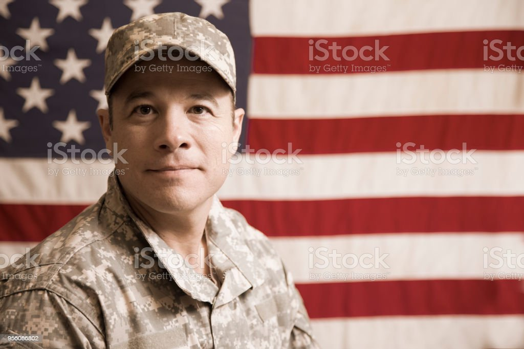 USA armed forces military man with American flag. stock photo