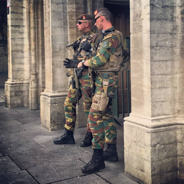 Armed forces patrolling Brussels city center, Belgium stock photo