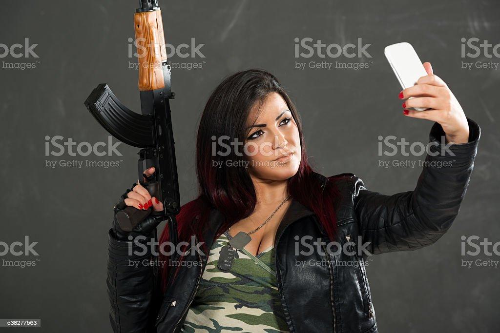 Armed Girl Taking Selfie stock photo
