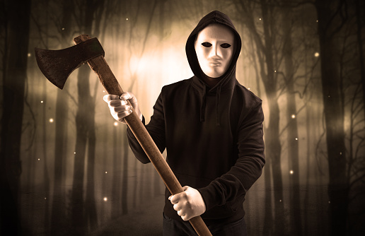 istock Armed hitman in dark nocturnal forest concept 953511000