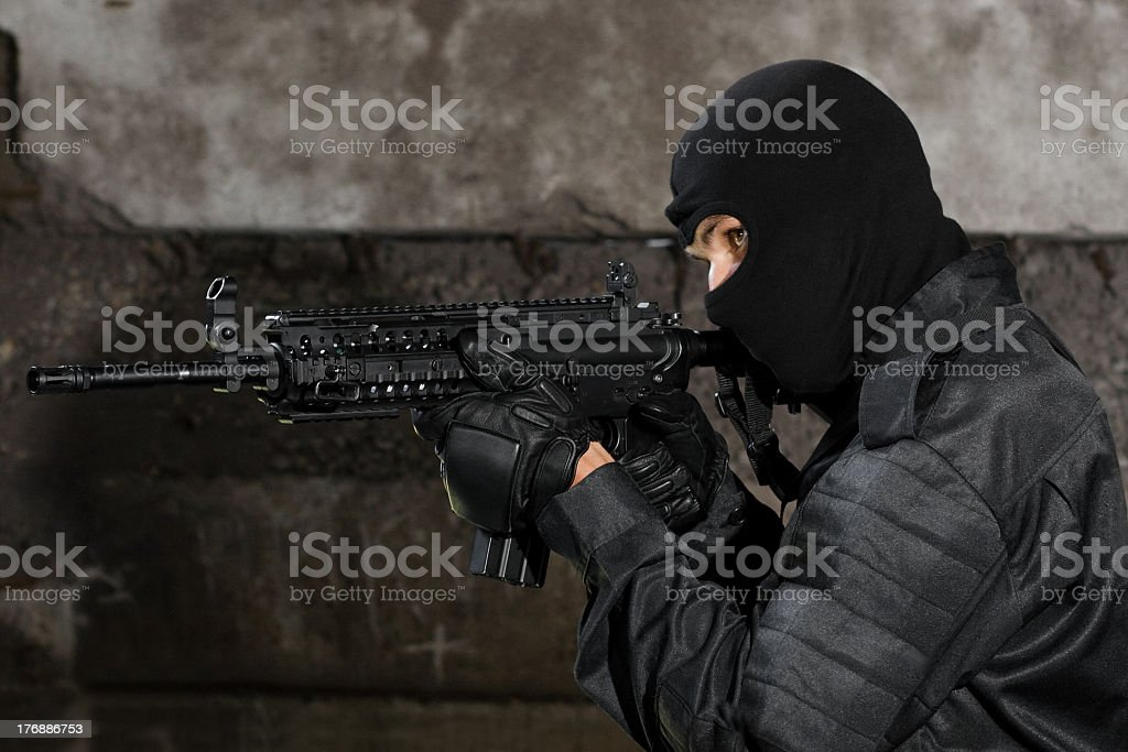 Armed man with automatic M-4 rifle stock photo