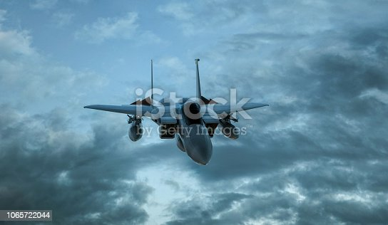 istock Armed military fighter jet in flight on the cloudly sky background - 3d render 1065722044